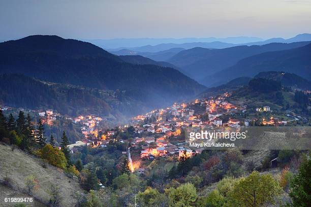 first nightlights in a mountainous town - plovdiv imagens e fotografias de stock