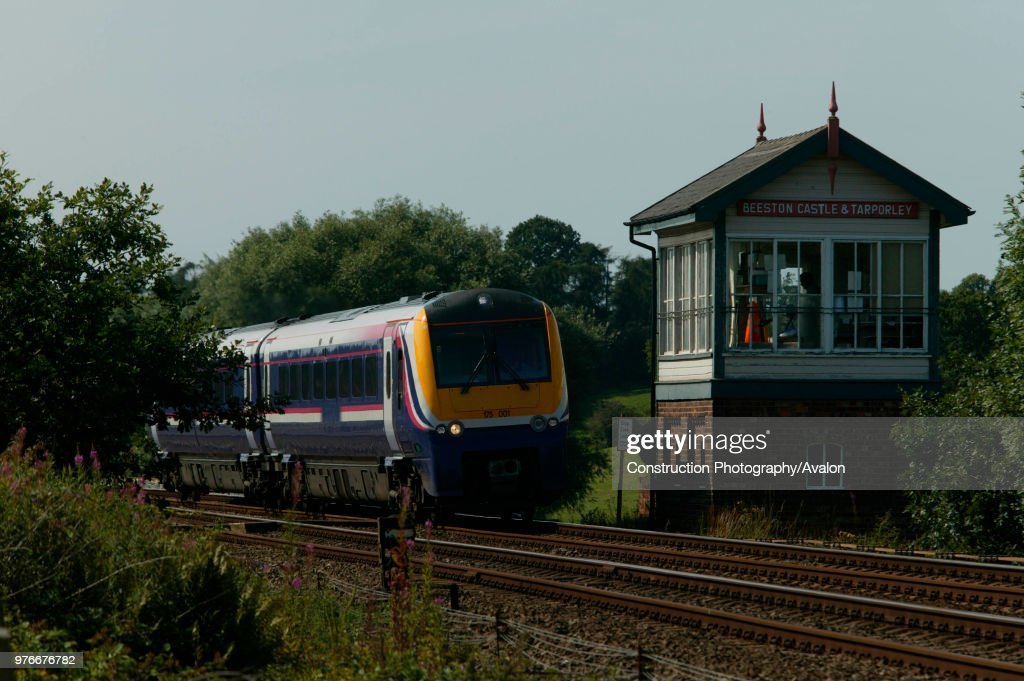 A First Northwestern class 175 DMU passes Beeston Castle and Tarporley signal box on the North Wales Main Line. Friday 30th July 2004. : News Photo