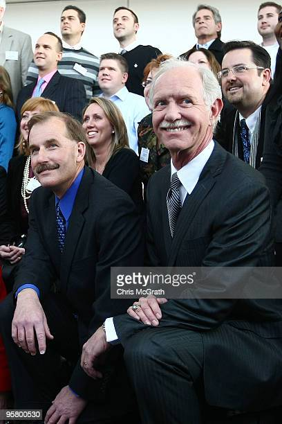 First Officer Jeffrey Skiles and Captain Chesley Sullenberger pose for a group photo with the passengers of US Airways flight 1549 during a reunion...