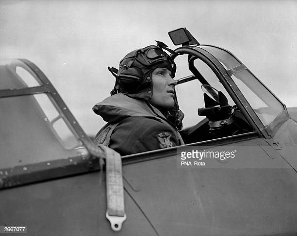First Officer 'Red' Tobin sits in the cockpit of his Hurricane fighter plane He is part of the famous 'Eagle' Volunteer Air Squadron which has joined...