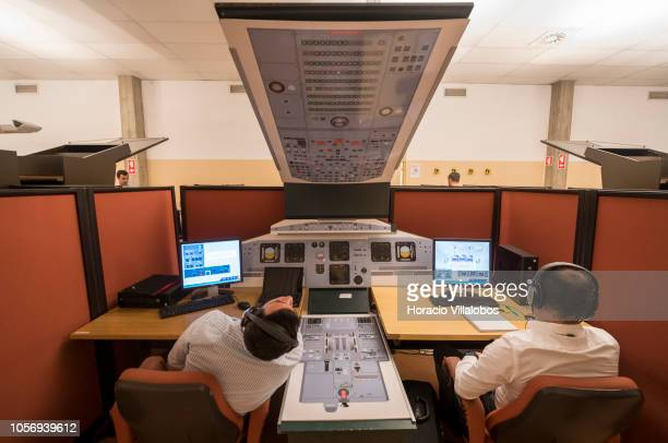 First Officers during a study session at a mockup cockpit for promotion to Pilot at TAP Air Portugal training center in Lisbon International Airport...