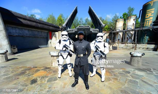 First Order officer and Storm Trooper pose in front of the TIE Echelon at the Star Wars Galaxy's Edge Walt Disney World Resort Opening at Disney's...