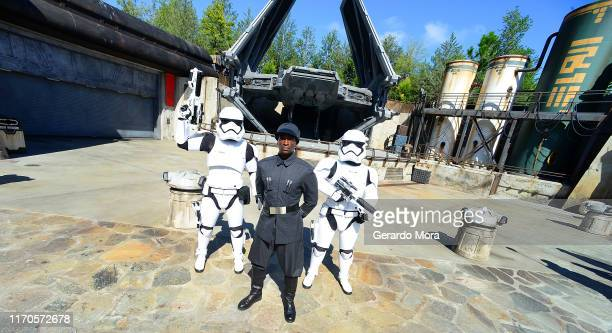 First Order officer and Storm Trooper pose in front of the TIE Echelon at the Star Wars: Galaxy's Edge Walt Disney World Resort Opening at Disney's...