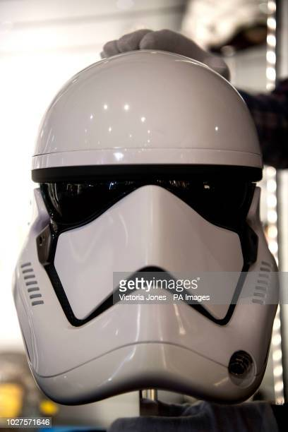 A First Order Stormtrooper Helmet from Stars Wars The Last Jedi at the Prop Store film memorabilia exhibition at the BFI IMAX at Waterloo in central...