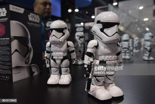 First Order Stormtrooper robots are seen on display during CES 2018 at the Las Vegas Convention in Las Vegas on January 12 2018 The robot has voice...