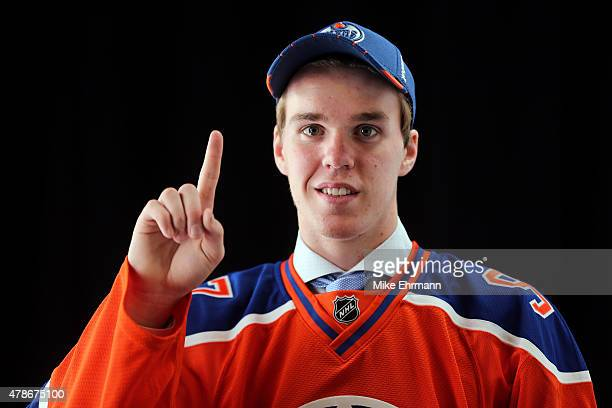 First overall pick Connor McDavid of the Edmonton Oilers poses for a portrait during the 2015 NHL Draft at BBT Center on June 26 2015 in Sunrise...