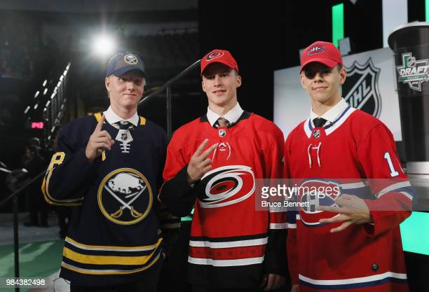 First overall Rasmus Dahlin of the Buffalo Sabres second overall Andrei Svechnikov of the Carolina Hurricanes and third overall Jesperi Kotkaniemi of...