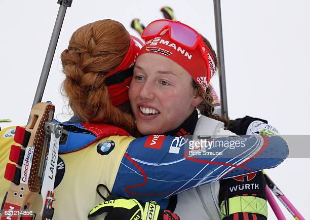 First palce winner Gabriela Koukalova of Czech Republic celebrates with second place winner Laura Dahlmeier of Germany after the 125 km women's Mass...