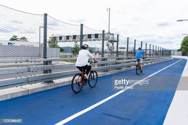 First people on bicycles ride on newly opened Mario Cuomo Bridge for pedestrian and bike riders path in Tarrytown Cuomo is opening up a shared use...