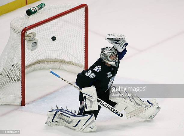 A first period goal shot by David Krejci of the Boston Bruins gets past Dwayne Roloson of the Tampa Bay Lightning in Game Six of the Eastern...