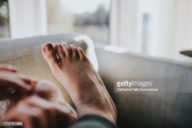 first person perspective - feet - cushion stock pictures, royalty-free photos & images