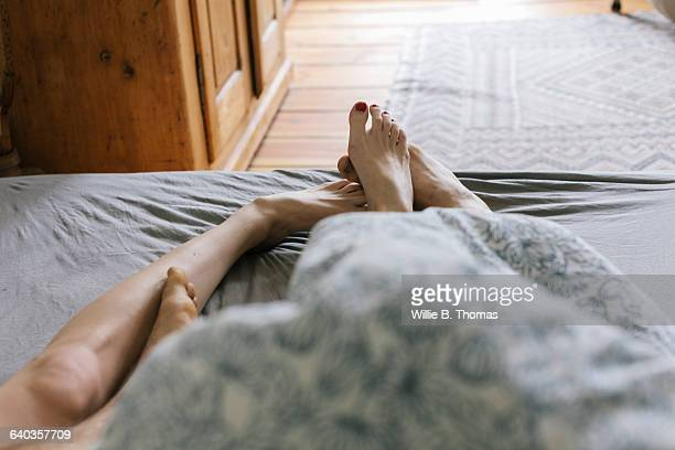 first person perspective of couple in bed - couple lit photos et images de collection