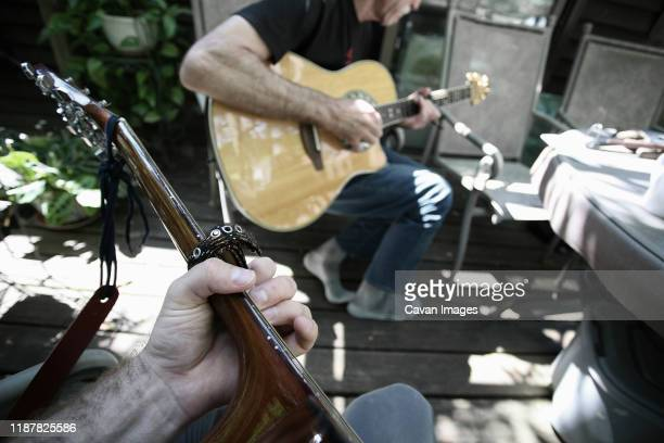 first person perspective playing guitar with another person. - musician stock pictures, royalty-free photos & images
