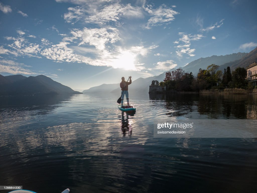 First person point of view of a woman paddling on a stand up paddle board : Stock Photo