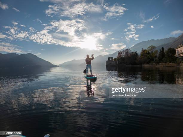 first person point of view of a woman paddling on a stand up paddle board - free stock pictures, royalty-free photos & images