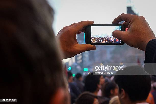 First person taking pictures to fans of the football team Talleres de Córdoba for victory celebrations in the center of the city of Cordoba Argentina...
