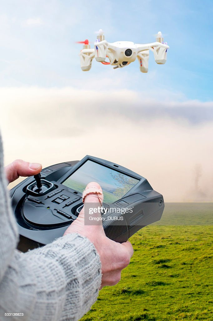 First person view drone flying with remote : Stock Photo