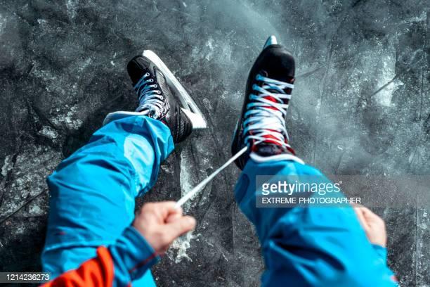 a first person view of lacing up the ice skates - patinagem artística imagens e fotografias de stock