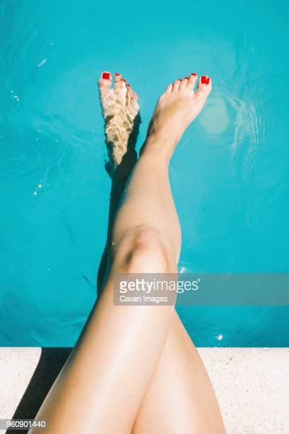 first person view of womans legs and feet at poolside