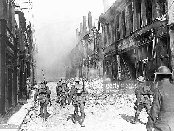 First pictures of Cambrai A patrol of the North Lancs marching into the town World War I photograph