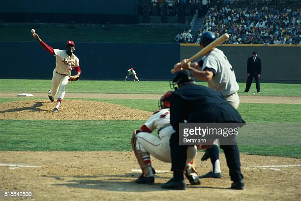 First pitch of 1968 World Series is delivered by Cards Bob Gibson to Tigers Dick McAuliffe who took it for a ball Catcher is Tim McCarver Umpire is...