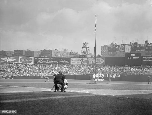 First Pitch of the 1955 Series New York New York Yankee pitcher Whitey Ford is following through after whipping up the first pitch of the 1955 World...