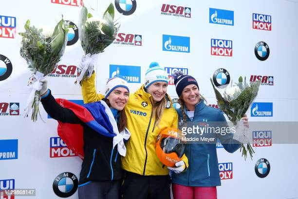 First place athletes Elena Nikitina of Russia Jacqueline Loelling of Germany and second place athlete Kendall Wesenberg of the United States...