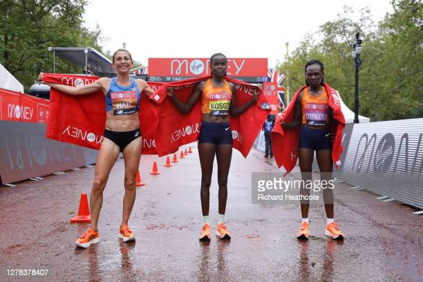 First place Brigid Kosgei of Kenya, second place Sara Hall of The United States of America and third place Ruth Chepngetich of Kenya pose for a photo...