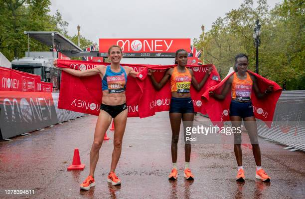 First place Brigid Kosgei of Kenya , second place Sara Hall of The United States of America and third place Ruth Chepngetich of Kenya celebrate...