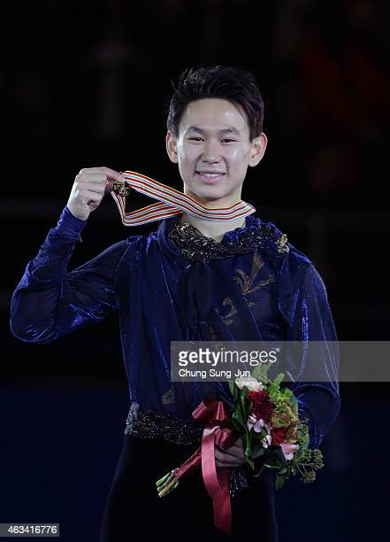 First place Denis Ten of Kazakhstan poses on the podium after the medals ceremony of the Men Skating on day three of the ISU Four Continents Figure...