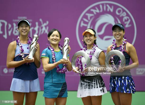 First place Ena Shibahara and Shuko Aoyama of Japan runner up Nao Hibino and Miyu Kato of Japan pose with their trophies after Women's doubles final...