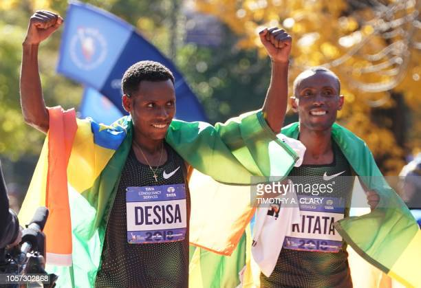 First place finisher Lelisa Desisa of Ethiopia and 2nd place Shura Kitata of Ethiopia celebrate during the Men's Division in the 2018 TCS New York...