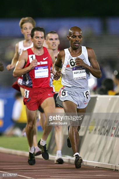 First place finisher Meb Keflezighi of Nike leads the pack in the 10000 Meter Run during the US Olympic Team Track Field Trials on July 9 2004 at the...