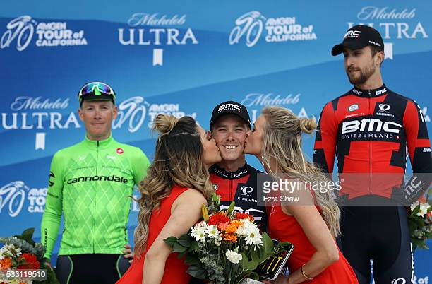 First place finisher Rohan Dennis of Australia riding for BMC Racing Team is kissed by the podium girls as second place finisher Andrew Talansky of...