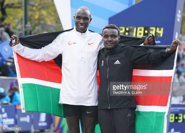 First place finishers Joyciline Jepkosgei of Kenya and Geoffrey Kamworor of Kenya pose during the 2019 TCS New York City Marathon in New York on...