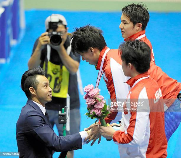 First place Ippei Watanabe shakes hands with Kosuke Kitajima on the podium at the medal ceremony for the Men's 200m Breaststorke during day three of...