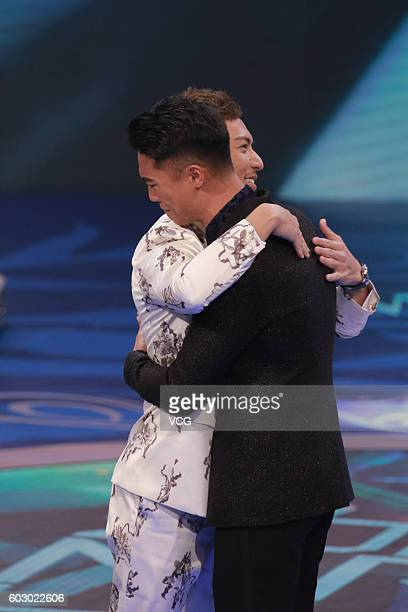 First place Jackson Lai celebrates with Mr Hong Kong 2007 champion Benjamin Yuen during the Mr Hong Kong Pageant 2016 at TVB City on September 11...