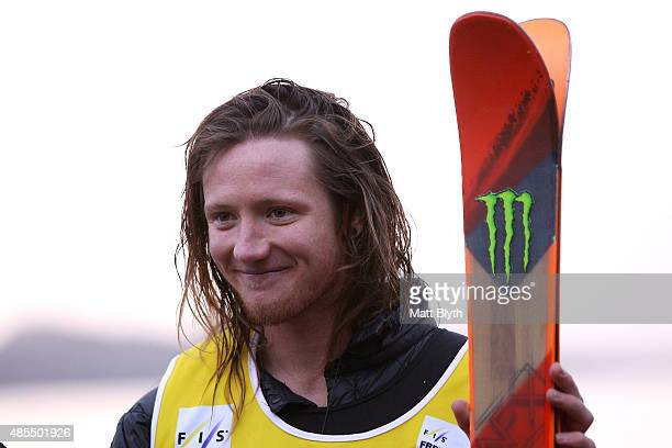 First place James Woods of Great Britain poses on the podium during the medal ceremony for the FIS Freestyle Ski World Cup Slopestyle Finals during...