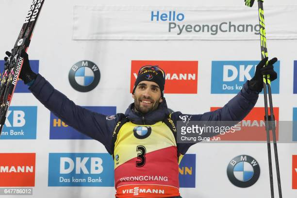 First place Martin Fourcade of France celebrates during the flower celemony for the Men 125km Pursuit during the BMW IBU World Cup Biathlon 2017 a...