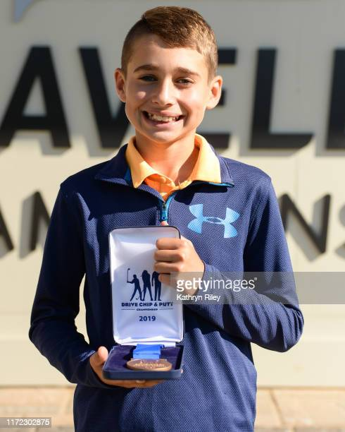First place overall for the boys 10-11 category Anthony Colonna poses for a picture during the Drive, Chip, and Putt Championship at TPC River...