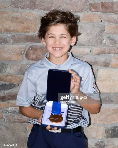 First place overall for the boys 7-9 category Cole Roberts poses for a picture during the Drive, Chip, and Putt Championship at TPC River Highlands...