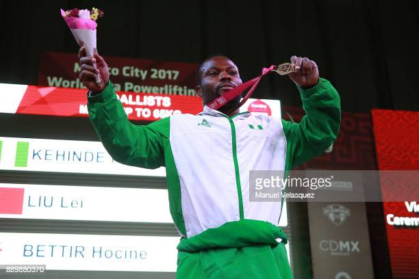 First Place Paul Kehinde of Nigeria celebrates with his medal during the Men's Up to 65Kg Group A Category as part of the World Para Powerlifting...