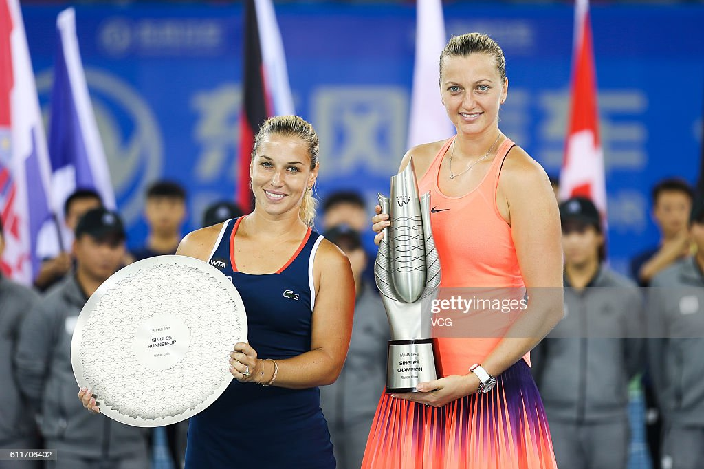 First place Petra Kvitova (R) of the Czech Republic and second place Dominika Cibulkova of Slovak pose with the trophies after the women's single final match on day seven of the 2016 WTA Dongfeng Motor Wuhan Open at Optics Valley International Tennis Center on October 1, 2016 in Wuhan, Hubei Province of China.