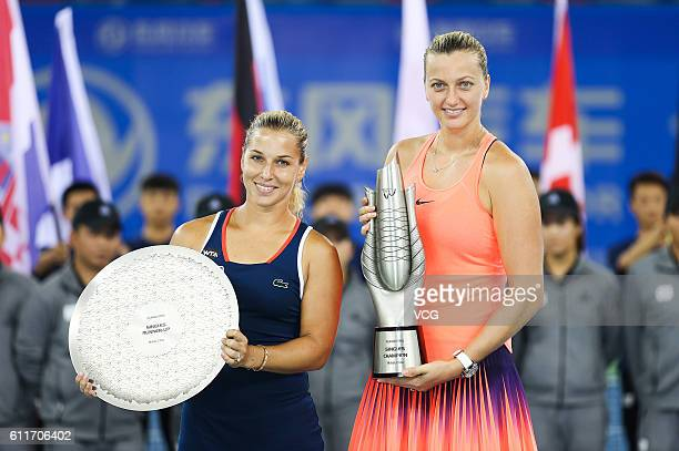 First place Petra Kvitova of the Czech Republic and second place Dominika Cibulkova of Slovak pose with the trophies after the women's single final...