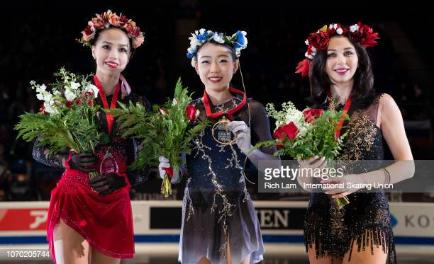First place Rika Kihira of Japan second place Alina Zagitova of Russia and third place Elizaveta Tuktamysheva of Russia pose for photos after the...