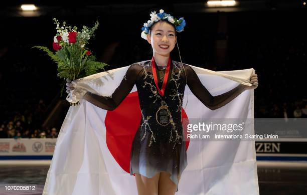 First place Rika Kihira of Japan second place Alina Zagitova of Russia and third place Elizaveta Tuktamysheva of Russia pose for photos during the...