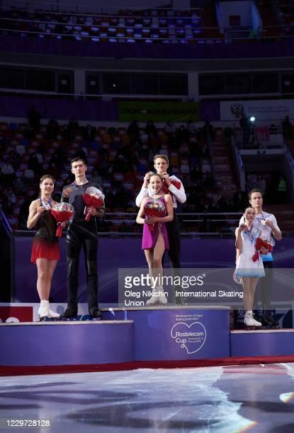 First place winner Aleksandra Boikova and Dmitrii Kozlovskii of Russa, second place winner Anastasia Mishina and Aleksandr Galliamov of Russia and...