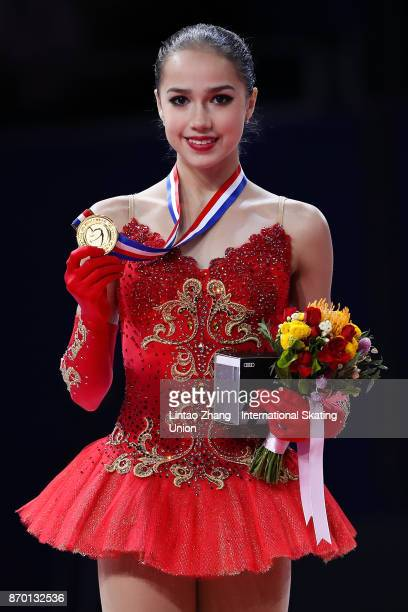 First place winner Alina Zagitova of Russia poses on the podium during the medals ceremony on day two of Audi Cup of China ISU Grand Prix of Figure...