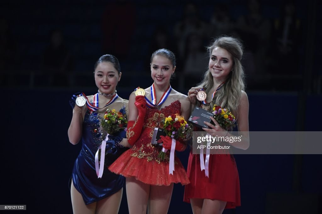 First place winner Alina Zagitova of Russia (Center), second place winner Wakaba Higuchi of Japan (L) and third place winner Elena Radionova of Russia(R) show their medals during an award ceremony at the Cup of China ISU Grand Prix of Figure Skating in Beijing on November 4, 2017. /