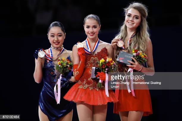 First place winner Alina Zagitova of Russia second place winner Wakaba Higuchi of Japan and third place winner Elena Radionova of Russia pose on the...